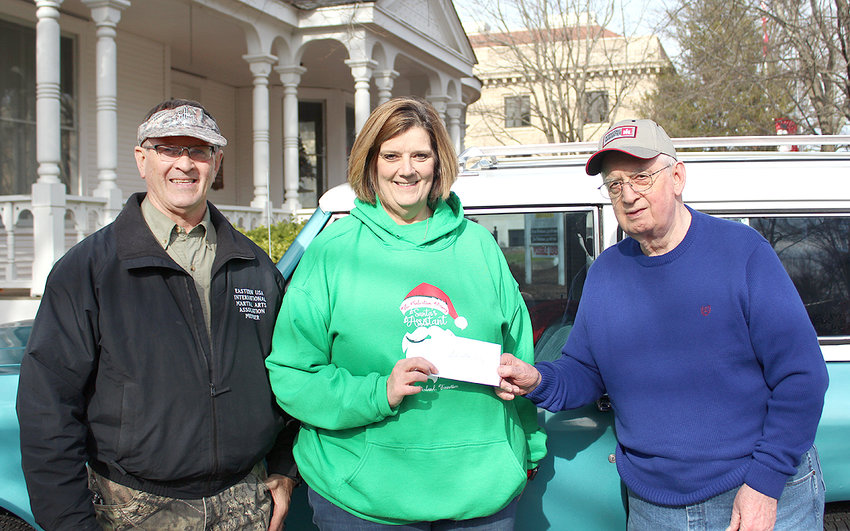 MAINSTREET Cruiser's Mark Howard, left, and Don Morrow, right, present a donation to the Salvation Army's Ruth Forgey.