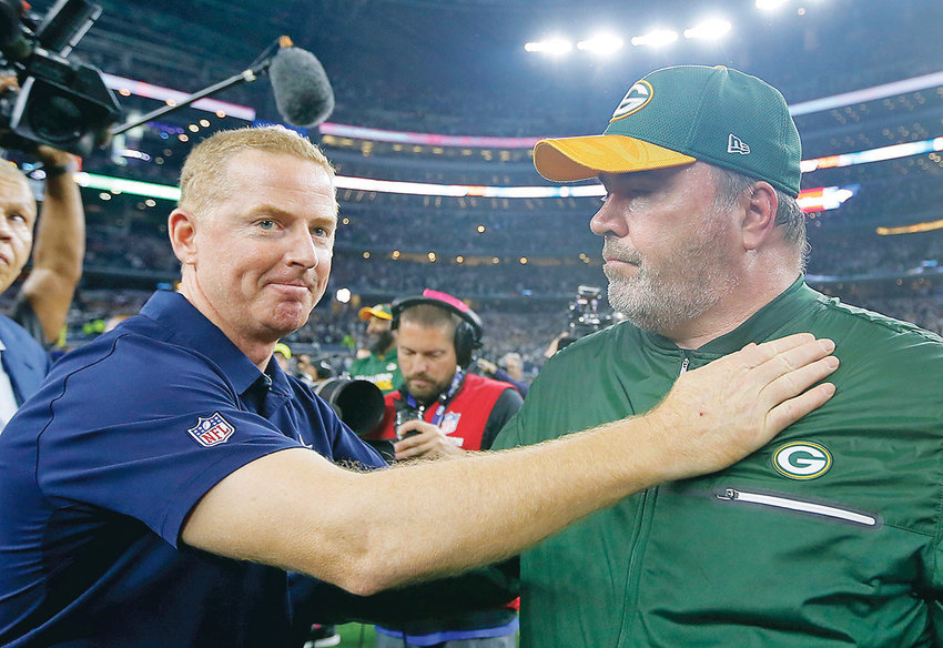 DALLAS COWBOYS coach Jason Garrett, left, congratulates Green Bay Packers coach Mike McCarthy after a 2017 win in Arlington, Texas. The Dallas Cowboys didn't take long to settle on Mike McCarthy as their coach after waiting a week to announce they were moving on from Jason Garrett.