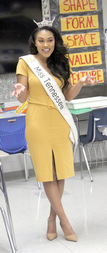 MISS TENNESSEE, Brianna Mason of Nashville, shrugs off the fact she couldn't answer a question from a student during her visit to Cleveland Middle School's Mentee Program Friday morning.