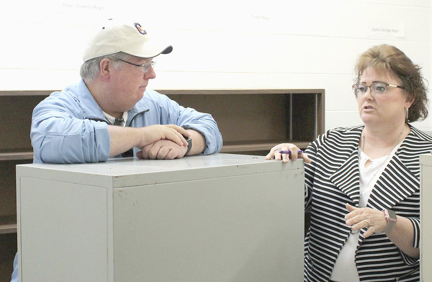 BRADLEY COUNTY Commissioner Milan Blake listens as Juvenile Director Vickie Towne discusses needed repairs for a back wall of the juvenile detention center. The wall is part of a storage room in the kitchen area.