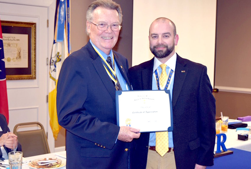 DAVID CARR, left, received a certificate of appreciation from chapter President Joseph A. White after a presentation on Col. Benjamin Cleveland.