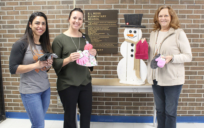 "Mitten Tree donations, collected by the Cleveland/Bradley Chamber of Commerce, help local school children. Students at E L Ross Elementary School were provided with a welcomed supply of winter mittens, gloves, hats and scarves thanks to the successful, collection of donated items from the Chamber's 2019 Mitten Tree.  ""We are very grateful to the Chamber for the donation of gloves and hats for our students,"" expressed Stephanie Stone, E.L. Ross Elementary School principal.  From left are E.L. Ross Elementary School guidance counseler Luz Price and Principal Stephanie Stone, along with the Chamber's Director of Workforce Development Sherry Crye."