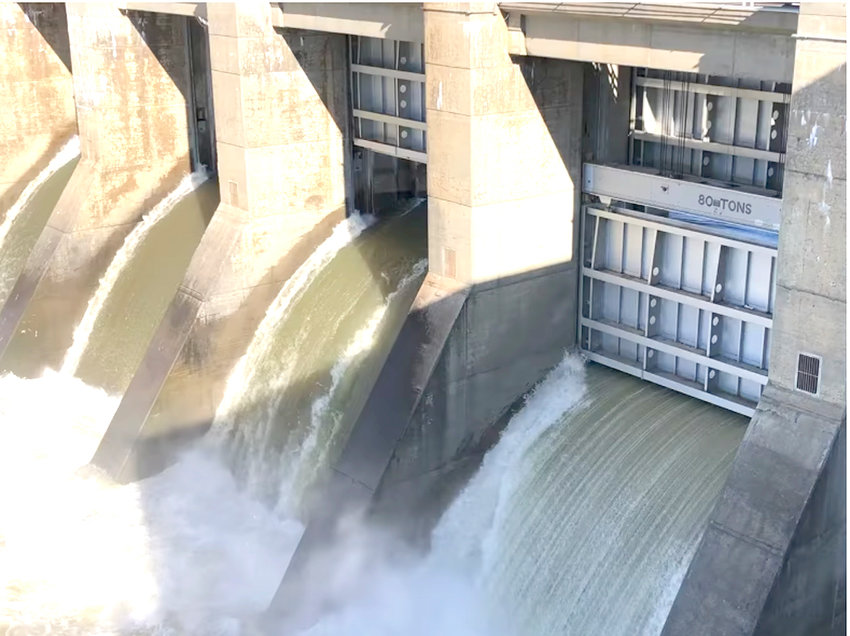 A SPILLWAY door at TVA's Chickamauga Dam rises to allow water to flow from its upper reservoirs in anticipation of heavy rains next week. According to TVA officials, the region has received one month's worth of rain in the last two days.