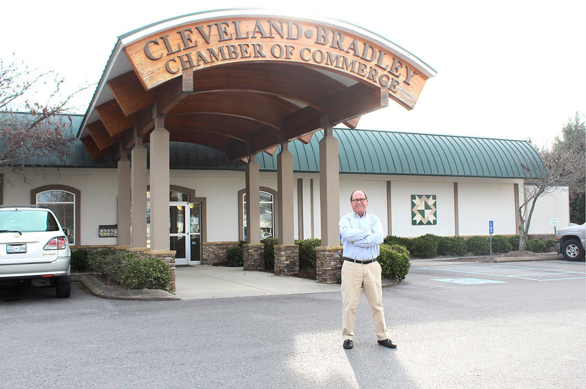 """MIKE GRIFFIN, president and CEO of the Cleveland/Bradley Chamber of Commerce, stands in front of the Chamber, which is located at the Village Green on Keith Street. Griffin says there is nothing in another city that he """"can't find right here."""""""