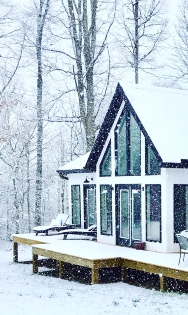 NICOLE PRINCE  shared a photo of the snow coming down Saturday and covering the porches.