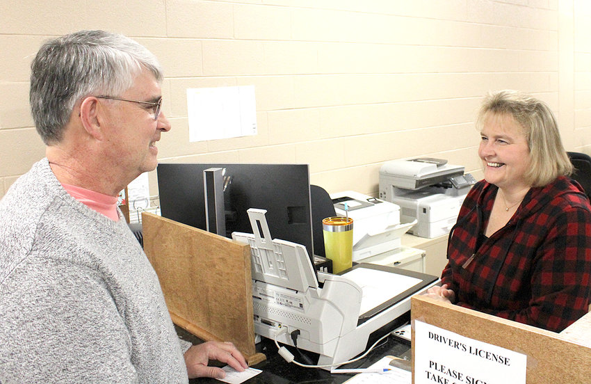 PHILIP LOWRY chats with Bradley County Clerk Donna Simpson while applying for his Real ID.