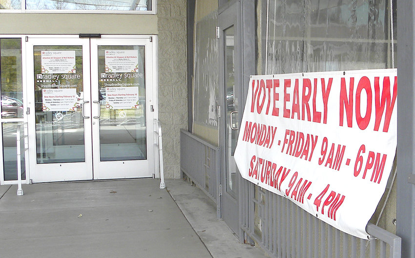 LARGE BANNERS hang by the doors closest to the early voting location at Bradley Square Mall. From 9 to 10 a.m., early voters need to use the door by OK Maguey restaurant, on the movie theater side of the mall. After 10 a.m., the other mall doors are opened.