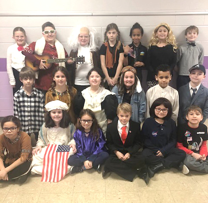 PROSPECT ELEMENTARY SCHOOL students in Linda Davis' third-grade class recently read biographies and wrote reports on famous Americans. These students also had the opportunity to dress as their famous American.  From left, front, are Ashley Springer as Pocahontas, Kaylyn Greenwood as Betsy Ross, Nessa Galanakis as Sandar Day O'Connor, Graeme Rodgers as Donald Trump, Emilynn Brown as Sally Ride and Phoenix Prater as Neil Armstrong,  Middle row left: Tyler Strohm as John F. Kennedy, Kayleigh Hall as Nancy Ward, Harley Dilbeck as Clara Barton, Sydney Pitman as Amelia Earhart, Amauri Howard as Barack Obama and Landon Boyette as Jimmy Carter.  Back row left:  Katie Taylor as Susan B. Anthony, Aidan Millsaps as Elvis Presley, Preston Linden as Benjamin Franklin, Brooklyn Banther as Sacagawea, Richard Kokello as Ronald Reagan, Rayelyn Holland as Dolly Parton and Nathan Cain as Millard Fillmore.