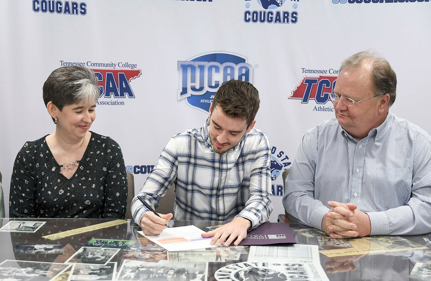 CSCC CROSS COUNTRY standout David Tullock signed a scholarship to run for Missouri Valley College. Pictured with Tullock are his parents, Christin and David Tullock.