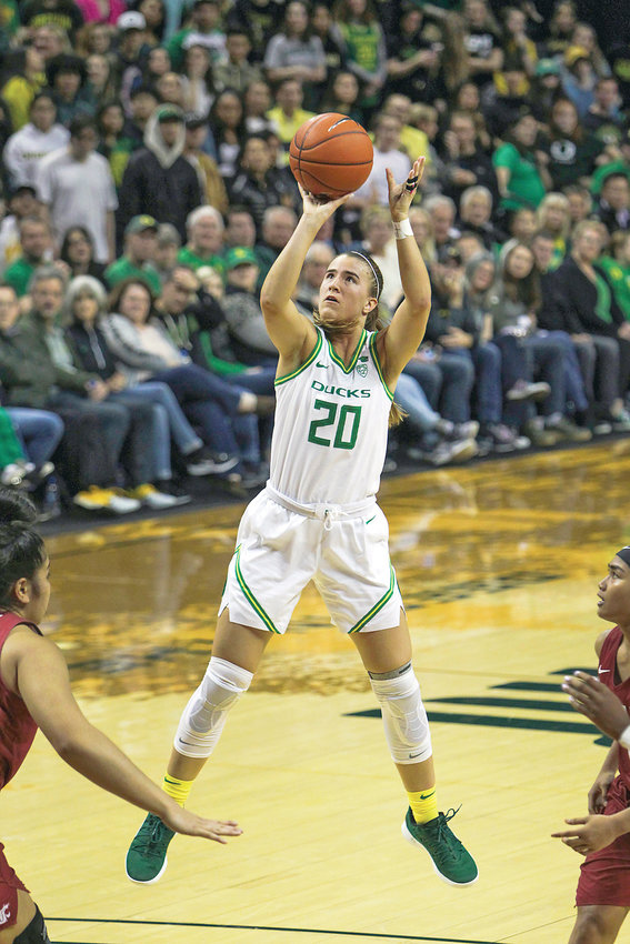FILE - In this Friday, Feb. 28, 2020, file photo, Oregon's Sabrina Ionescu shoots against Washington State in an NCAA college basketball game in Eugene, Ore. Ionescu capped off a unprecedented college career by entering an exclusive club. Oregon's star guard was a unanimous choice Monday, March 23, 2020, as The Associated Press women's basketball player of the year. (AP Photo/Collin Andrew, File)