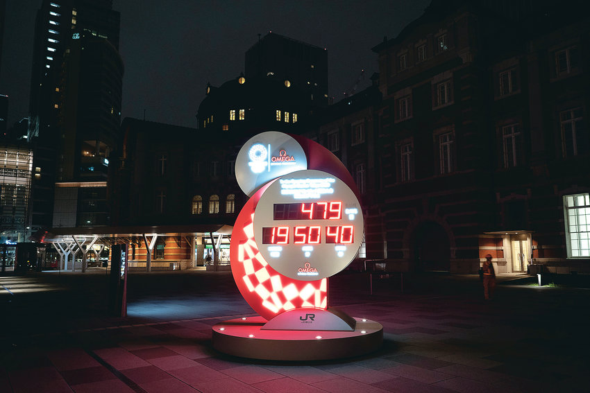 A COUNTDOWN CLOCK displays the remaining days until the new start date for the Tokyo 2020 Olympics today, in Tokyo. The Tokyo Olympics will open next year in the same time slot scheduled for this year's games. Tokyo organizers said Monday the opening ceremony will take place on July 23, 2021.