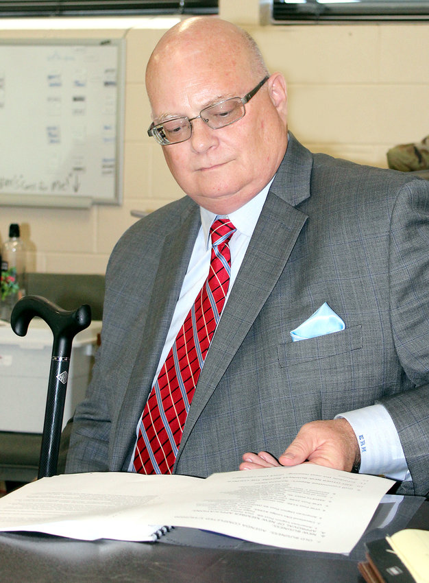 ED HARRIES, executive director of the Tennessee Veterans Home Board, scans through his notes as he prepares to make a presentation to members of the Southeast Tennessee Veterans Home Council Thursday evening. Harries informed the council site preparation for the $47 million Bradley County Tennessee State Veterans Home has been hampered by the weather, forcing the projected completion to be pushed back to Spring 2022.