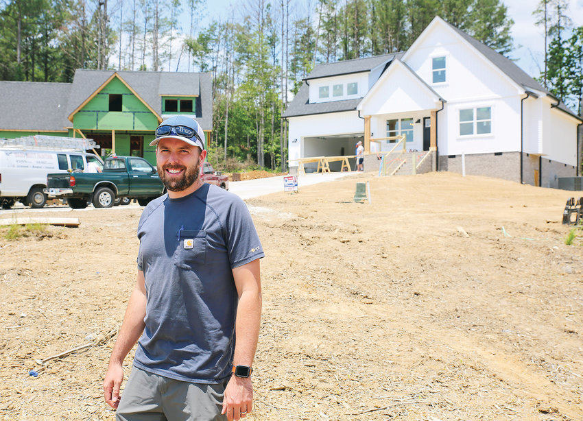 BUILDER BLAKE ALLISON stands in front of homes currently being constructed within the Stone Creek subdivision. In spite of the COVID-19 pandemic, residential construction inside the city of Cleveland remains strong, according to builders and real estate agents.