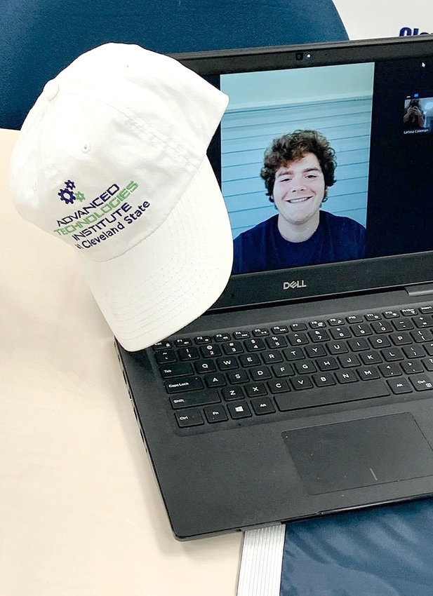MASON COCHRAN, an incoming freshman at Cleveland State, seen on the laptop, appeared virtually from out of state for his signing day.