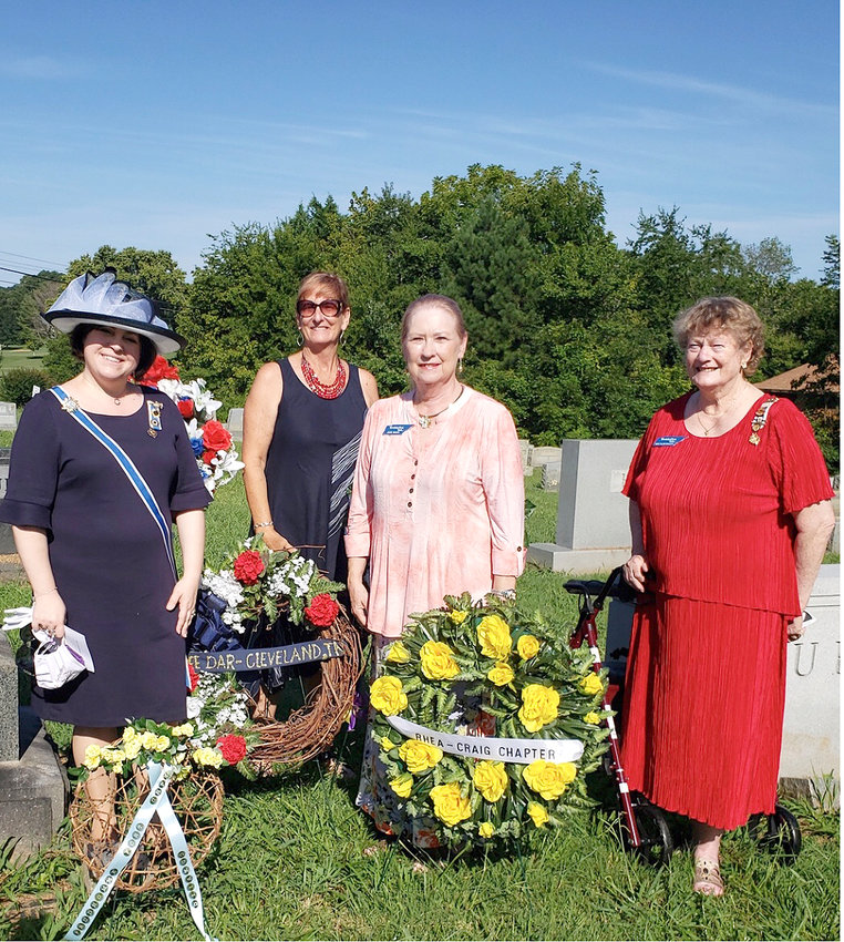 ON HAND FOR A wreath-laying in Niota Cemetery for the late Febb Burn were, from left, TSDAR State Regent Cecile Wimberley, Ocoee Chapter Women's Issues chair Betsy Bassette, Ocoee Chapter lbrarian Judie Brock, and TSDAR Cherokee district director and grandniece of Febb Burn Mary Ellen Nolletti.