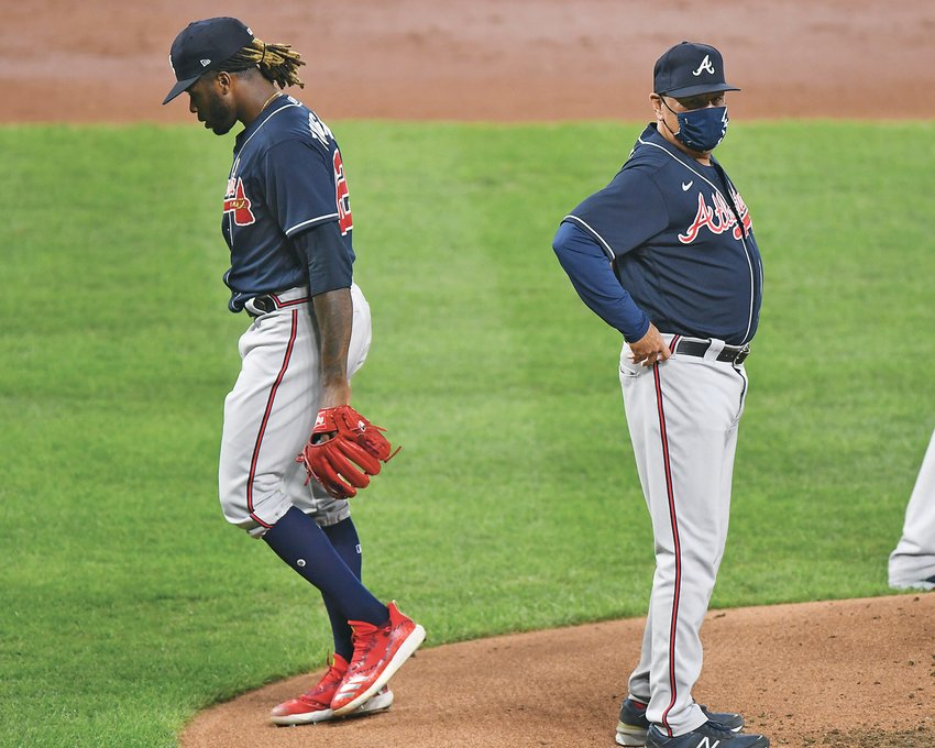 ATLANTA BRAVES' starting pitcher Touki Toussaint (62) is removed by manager Brian Snitker (43) in the third inning against the Baltimore Orioles Monday, in Baltimore.