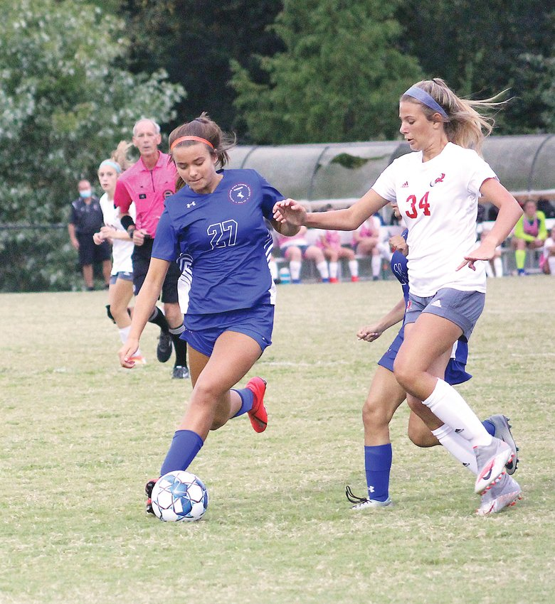 LADY RAIDERS' Milah Williams (27) battles an Ooltewah defender during a District 5-AAA soccer match  Wednesday, at the Greater Cleveland Soccer Complex.