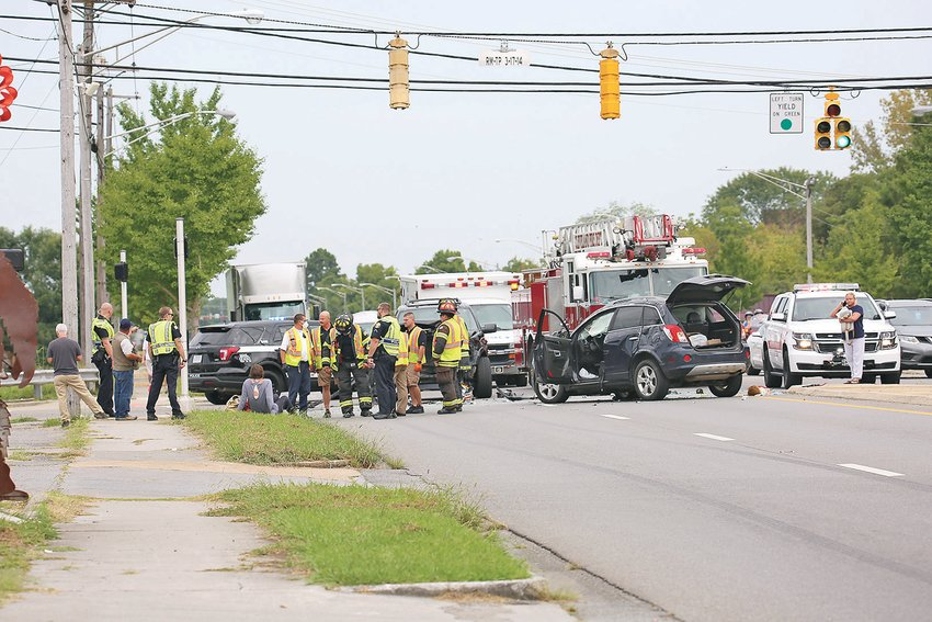 THE CLEVELAND FIRE and Cleveland Police Departments work the scene of a head-on collision at the intersection of Keith and 20th Street on Wednesday during the 12 p.m. hour that had one side of Keith Street shut down for a period of time.