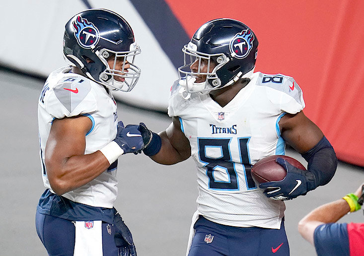 TENNESSEE TITANS' tight end Jonnu Smith (81) celebrates his touchdown catch with running back Khari Blasingame in the second half against the Denver Broncos Monday, in Denver.