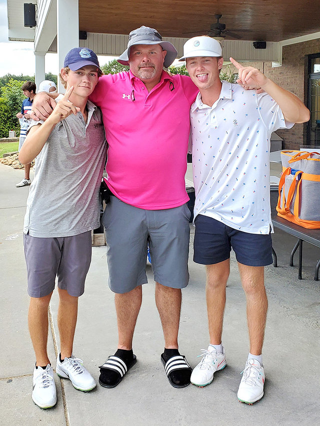 "THE TEAM OF Matthew Ott, Tommy ""Big Tom"" Anderson, and Wes Spillers, from left,  finished second in the Tyler Westmoreland Memorial Golf Tournament with a score of 50 The big news of the day was on hole 14, when Spillers sunk a hole-in-one witnessed by his playing partners. Not pictured is team member Tony Farmer."