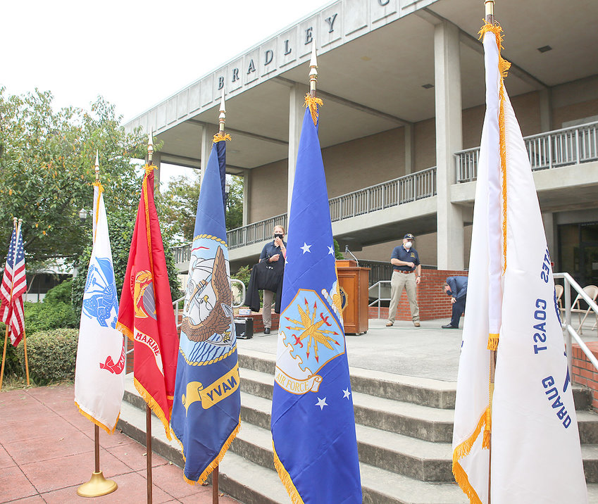 THE FIVE MILITARY FLAGS representing each of the five branches stand on the steps of the Bradley County Courthouse Saturday morning for the flag dedication ceremony for the 10th Judicial District Veteran's Treatment Court.