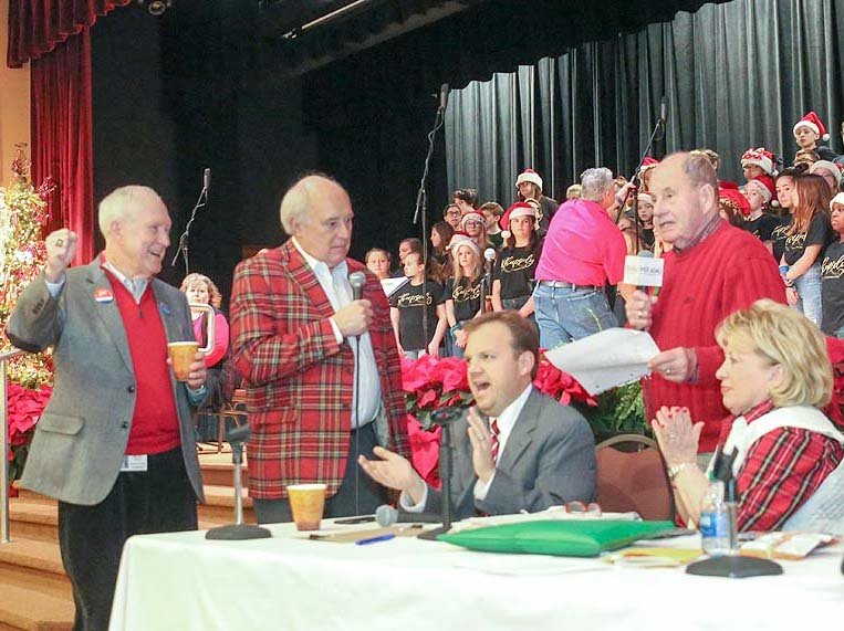AT YEAR'S END, Life Care Centers of America President Beecher Hunter, left, would always host the grand finale broadcast for the annual Empty Stocking Fund. In this file photo from 2019, Hunter cheers as Cleveland Mayor Emeritus Tom Rowland announces that the ESF campaign had exceeded $106,000 in donations. From left are Hunter, James F. Logan Sr., Steve Hartline, Tom Rowland and Sandra Rowland. The Empty Stocking Fund grand finale, which concludes a two-week campaign by WCLE radio, is traditionally held in Life Care's Professional Development Center on Keith Street.