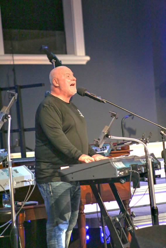 CHRIS MCDANIEL SINGS and plays the keyboard during the Celebrate Recovery event on Thursday evening at South Cleveland Church of God.