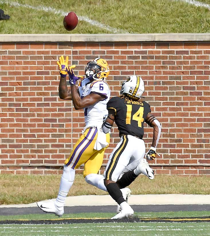 LSU WIDE RECEIVER Terrace Marshall Jr. (6) catches a touchdown pass as Missouri defensive back Adam Sparks (14) defends in the first half Saturday, in Columbia, Mo.