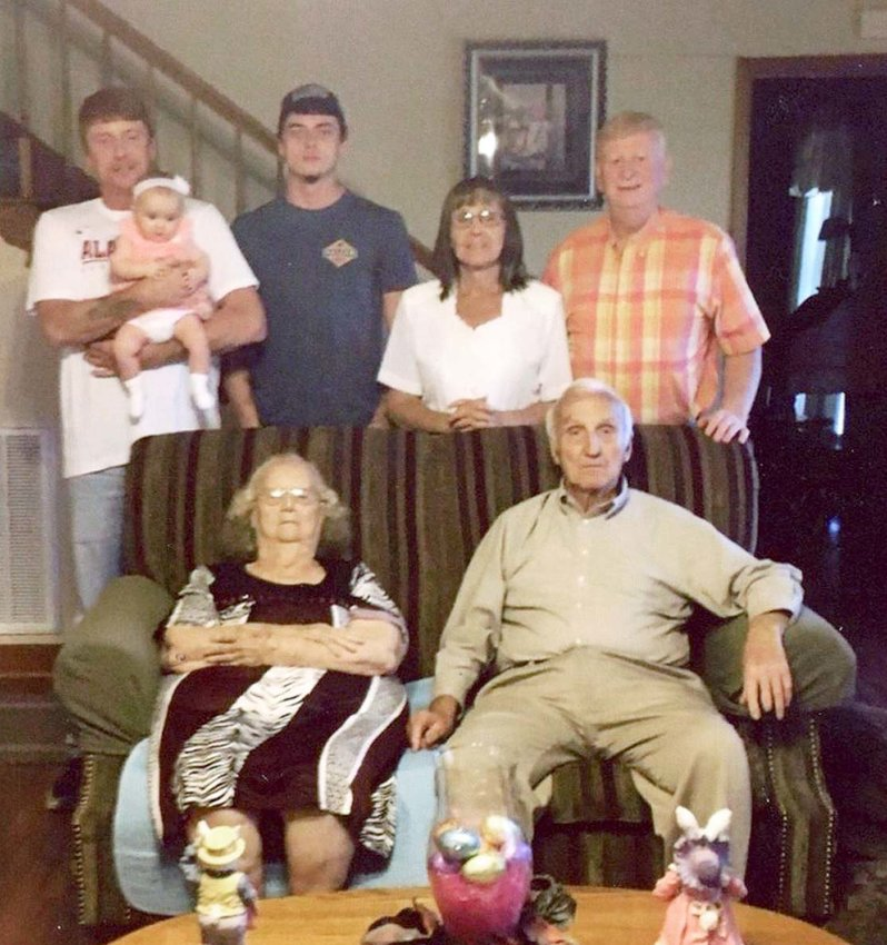 FIVE GENERATIONS of the Anderson and Lawson family recently gathered. Seated are great-great-grandparents Fred and Katherine Anderson; standing, from left, grandfather Heath Lawson holding Ivy Lyn Lawson; father Waylon Lawson; and great-grandparents Dean and Jenell Lawson.