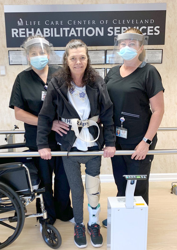 Camila Hilton, physical therapist assistant; Janet Randolph; and Lisa Palen, occupational therapy assistant, worked as a team to get Randolph on her feet and home.