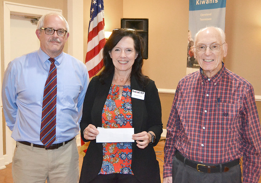 RENEE CURRY, center, Isaiah 117 House manager, spoke to members of the Kiwanis Club of Cleveland at its recent meeting. She was presented a donation by the club following her presentation by Kiwanis Club president Richard Hughes, left, and Vince McGaughlin, who was celebrating his 80th birthday at that same meeting.