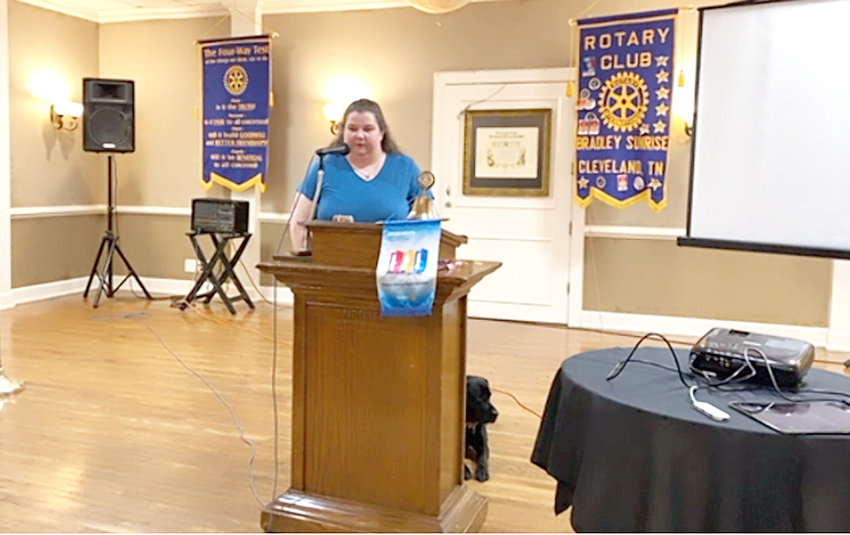 CHRISTY O'DELL, president of the local chapter for the National Federation of the Blind, speaks at Bradley Sunrise Rotary on Thursday with her seeing-eye dog Wiggles.