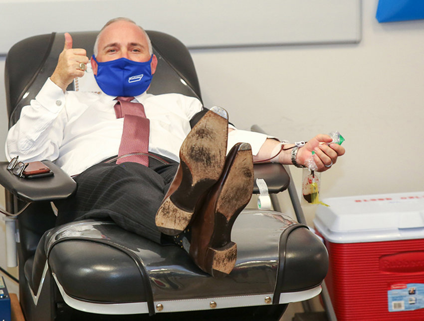 CLEVELAND MAYOR KEVIN BROOKS, who is a COVID-19 survivor, gives a thumbs-up during a recent plasma donation at the Blood Assurance donation center at The Village Green. Blood Assurance is in dire need of donors during the Thanksgiving season because many local drives and mobile events in the region have been canceled due to the spread of COVID-19.
