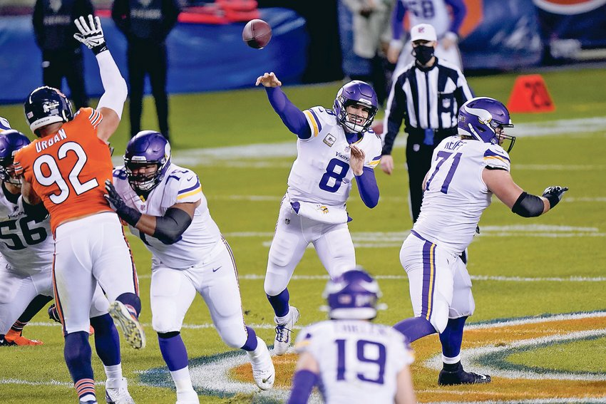MINNESOTA VIKINGS quarterback Kirk Cousins (8) throws during the first half against the Chicago Bears Monday, in Chicago.