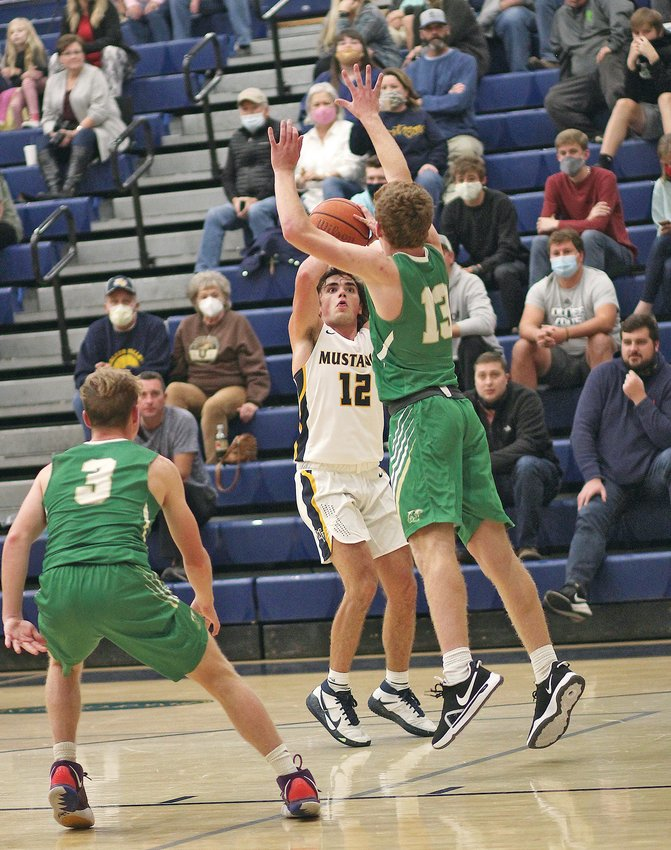 WALKER VALLEY'S Cole Harbison (12) puts up a 3point shot in the second quarter against Rhea County. Harbison led the Mustangs with 15 points in the season-opening win over the Golden Eagles.