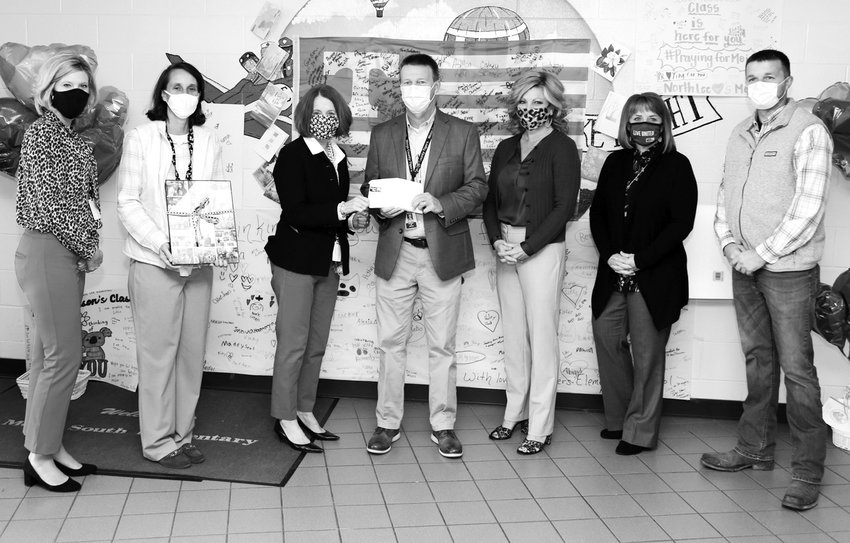 ADMINISTRATORS make a donation of more than $20,000 to Meigs County Schools for families affected by the fatal Oct. 27 bus crash. From left are Brittany Cannon, Meigs South Elementary Principal Rachel Moore, Director of Bradley County Schools Dr. Linda Cash, Meigs County Superintendent Clint Baker, United Way of the Ocoee Region Executive Director Stephanie Linkous, Meloyne Adams of the United Way of McMinn and Meigs Counties, and Midlab Inc.'s Daniel Lakes.