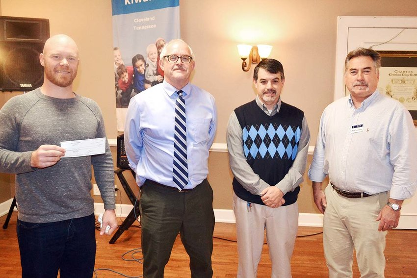 THE KIWANIS CLUB of Cleveland recently had City Fields' Dustin Tommey and Brian Stewart of The Refuge explain the recent merger of the two organizations. From left are Tommey, Kiwanis Club President Richard Hughes, Stewart, and Kiwanis Club member Bob Sanders.
