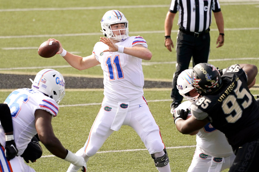 FLORIDA QB Kyle Trask (11) passes against Vanderbilt in the first half of Saturday's SEC game in Nashville. Trask tossed a trio of TDs in the 38-17 romp over the Commodores.