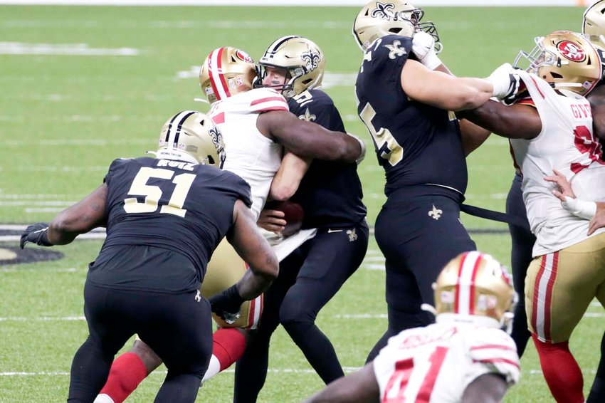 IN THIS Nov. 15, 2020, file photo, San Francisco 49ers defensive end Kentavius Street (95) sacks quarterback Drew Brees (9) during the first half of an NFL game in New Orleans. The Saints placed Brees on injured reserve Friday, meaning he'll miss at least three games with rib injuries. Brees was unable to finish last Sunday's game after absorbing a heavy hit on a sack attempt by 287-pound San Francisco defensive tackle Street, who was penalized for roughing on the play.