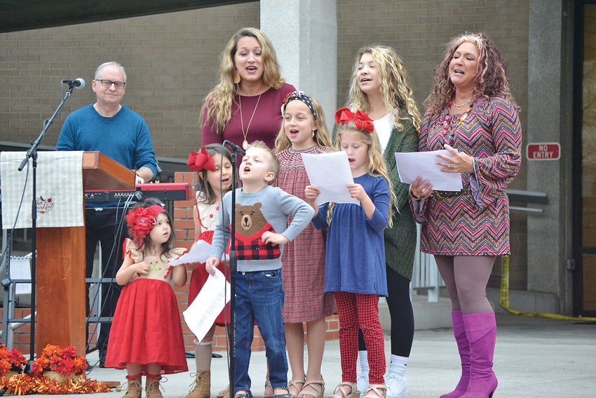 "MEMBERS OF THE Marek, Smartt and Wilcox families sang ""The Butterfly Song"" at the Com-Unity Celebration of Praise and Thanksgiving program at the Bradley County Courthouse Sunday."