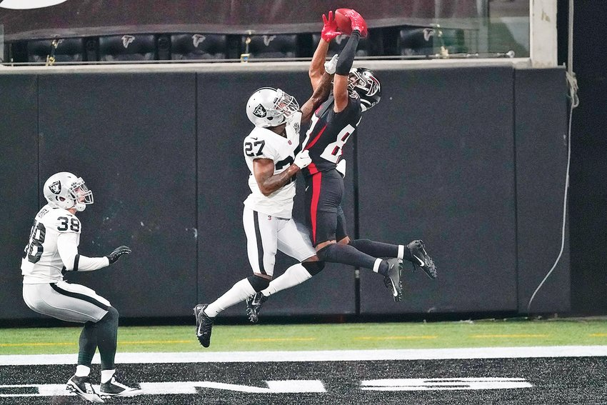 ATLANTA FALCONS wide receiver Russell Gage (83) misses the catch in the end zone against Las Vegas Raiders cornerback Trayvon Mullen (27) in the first half Sunday, in Atlanta.