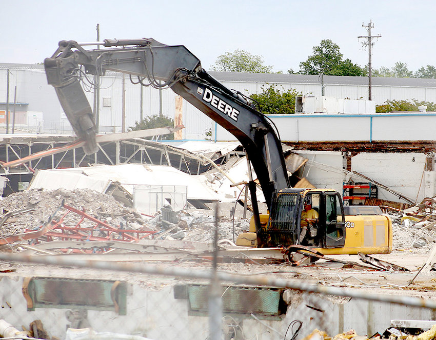 THE ANGLE in this file photo shows old Whirlpool Plant 1 West being ripped apart by a piece of heavy machinery. Demolition work began in March 2019, and crews have already tumbled Plant 2 and Plant 1 East. After Plant 1 West was finished, crews headed over to the old Flat-Top building. Pictured below are some of the Plant 1 West remains. In the background is the Flat-Top building.