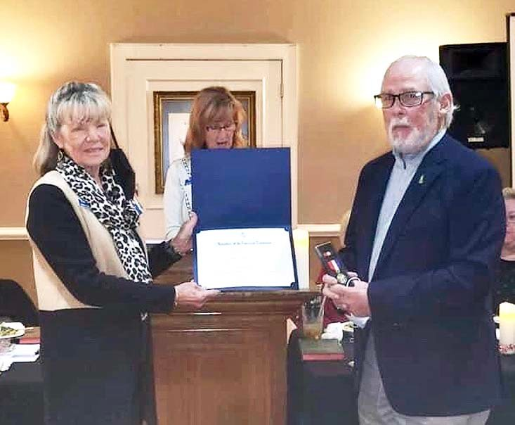 Joanne Swafford, left, first vice regent, presents the Distinguished Citizen Medal to Hank Hayden, while Betsy Bassette second vice regent, center, reads his biography.   ?