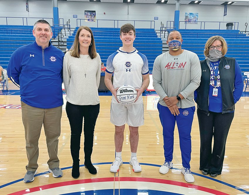 CLEVELAND BLUE RAIDERS SENIOR Grant Hurst was recognized during halftime of the Cleveland-Knoxville Webb girls basketball game for scoring his 1000th career point. From left, parents Matt  and Wendy Hurst, Grant Hurst, Blue Raiders head coach Reggie Tucker and Cleveland principal Autumn O'Bryan.