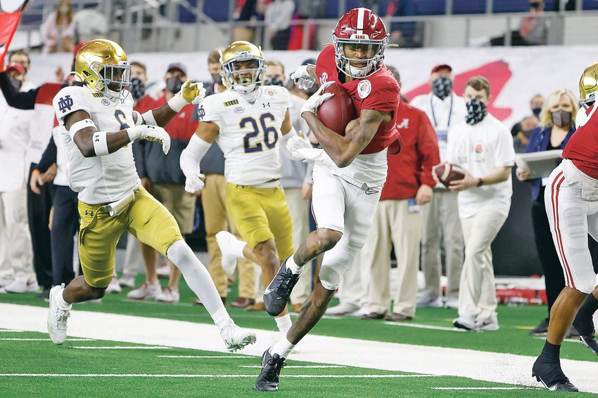 ALABAMA WIDE RECEIVER DeVonta Smith (6) became the firstr wie receiver in 29 years to be awarded the Heisman Trophy. Smith beat out a trio of quarterbacks, teammate Mac Jones, Clemson's Trevor Lawrence, and Florida's Kyle Trask.