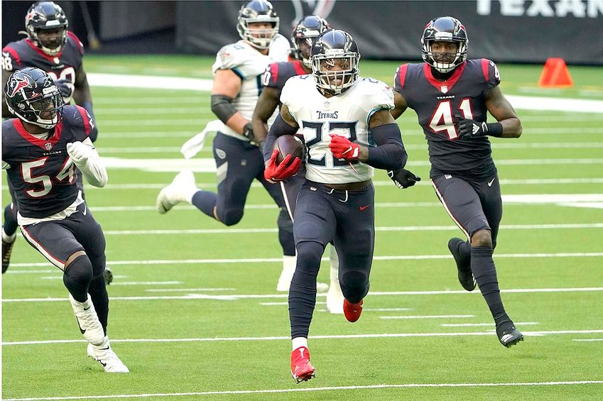 TENNESSEE TITANS running back Derrick Henry (22) rushes for a touchdown against the Houston Texans Jan. 3, in Houston.