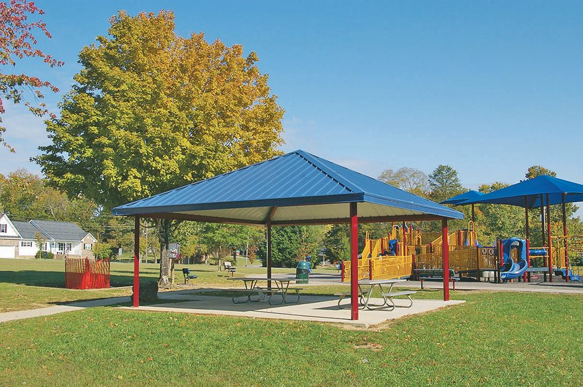THE PLAYGROUND includes fun equipment for youngsters as well as ADA-compliant sidewalks and parking lot with handicapped space. Bathrooms and a small pavilion have been added over the years.