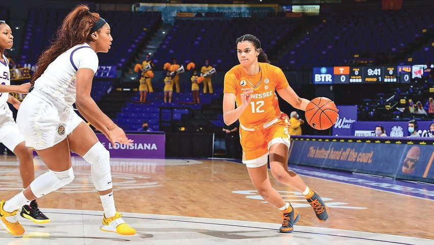 TENNESSEE JUNIOR Rae Burrell (12) pumped in 18 points to lead the Lady Vols past LSU 64-63 Sunday, in Baton Rouge, La.