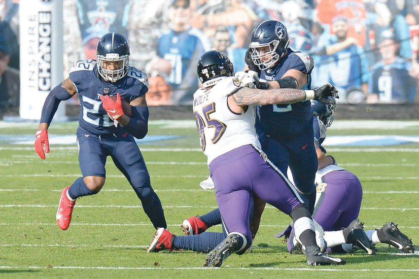TENNESSEE TITANS running back Derrick Henry (22) carries the ball past Baltimore Ravens defensive end Derek Wolfe (95) in the first half of Sunday's NFL wild-card playoff game, in Nashville.