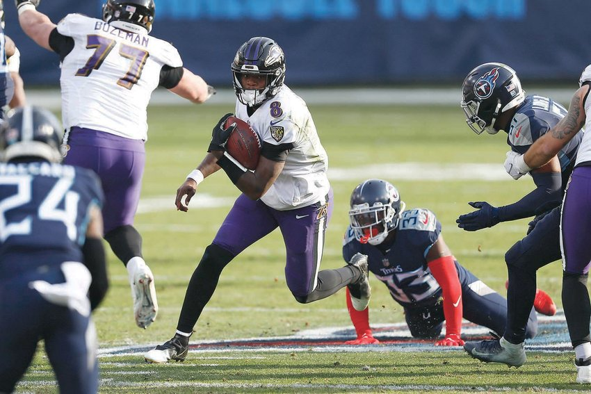 BALTIMORE RAVENS QB Lamar Jackson (8) scrambles against the Tennessee Titans in the second half of Sunday's NFL wild-card playoff football, in Nashville.